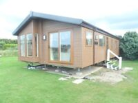 Stunning Lodge for sale on desirable beach front holiday park North Wales