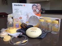 Medela Swing Breastpump with bottles and calma teet