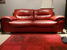 Large red leather sofa and foot stool exellent condition
