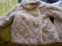 girls fur coat ,age 12-18months (big though)