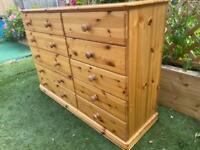 Solid chunky pine large chest of drawers. Solid heavy quality build. Possible delivery