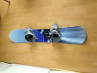 140cm snowboard with bindings and stomp pad