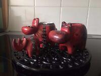 Set of beautiful red rhinos soapstone candle holder set