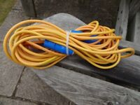 Heavy duty 20 meter caravan hook-up cable with male and female connectors.