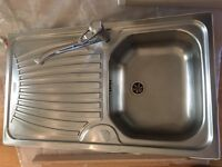 Stainless steel kitchen sink with tap