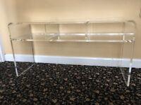 Clear Acrylic Plastic table with shelf.
