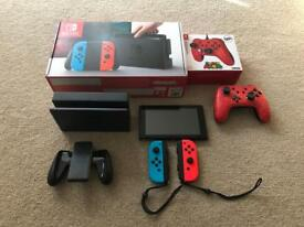 Nintendo Switch console and Super Mario Controller - like new
