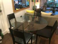 Round glass dining table table and. Chairs