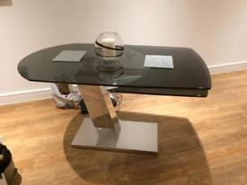 Smoked glass extendable dinning table 76 cm H x 87 cm W x 140cm L/180 cm L extended