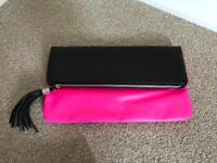 Neon pink and Black clutch bag