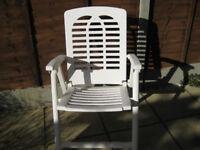 white plastic garden arm chair