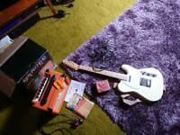 Fender guitar and Orange amp