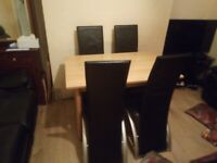 Wooden dining table with 4 black leather chairs (DELIVERY AVAILABLE)