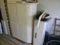Howdens Cream Gloss Kitchen Units and black granite worktops
