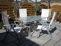 GARDEN TABLE AND 4 HIGH BACK FOLDING CHAIRS