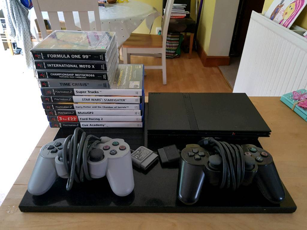 Sony PS2 Slim + Controllers + Games