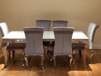Immaculate condition dining table with chairs