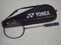 A collection of badminton rackets and covers
