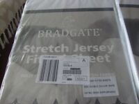 Two new packaged stretch jersey fitted double bed sheets