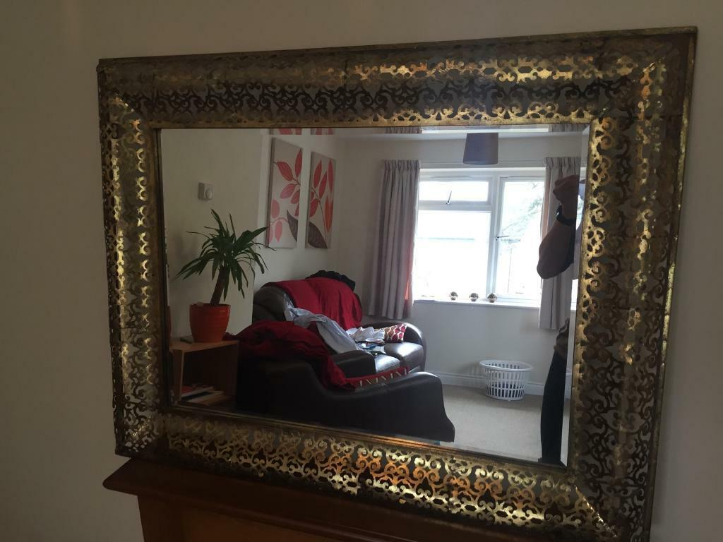 Morrocan style metal mirrorin Colchester, EssexGumtree - A fantastic mirror that looks great and suits a variety of styles. There are holes in the back So that it can be hung either landscape or horizontal. It measures 29 inches by 37 inches. Viewings and questions welcome, from a smoke and pet free home