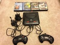 Sega Megadrive, 2 Controllers, Tv Connector and 4 Games