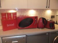 Red Next microwave, bread bin, kettle, toaster, tea/coffee/sugar canisters