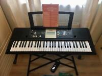 Yamaha Digital Keyboard +stand, pedal & books
