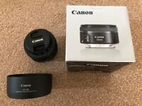 Canon 50mm 1.8 STM lens with Canon Hood and filter.