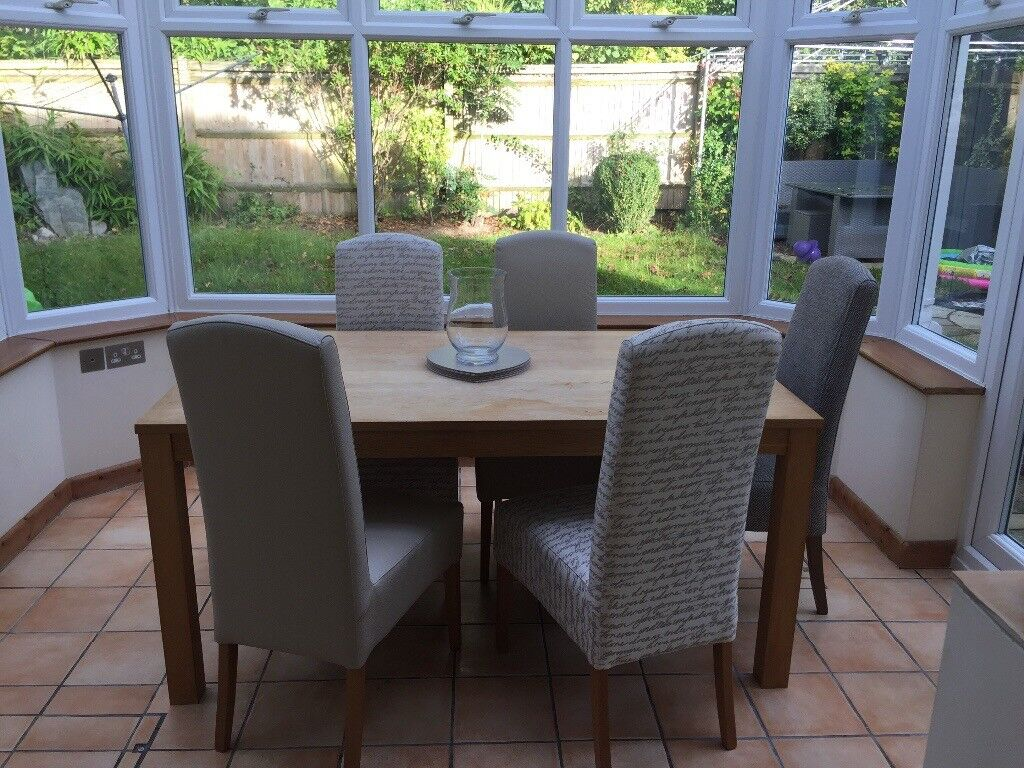 Sold subject to collection- Large extending wooden table and 6 chairs dining set