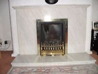 White marble fire surround and living flame gas fire