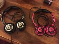 2x skullcandy over ear headphones. Pink & Black / Black & Silver