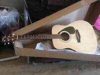 Yamaha F310 Acoustic guitar for sale 2 months old