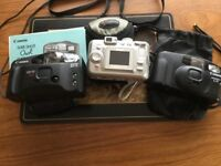 Kodak Easyshare digital camera and case. Two Canon manual cameras with cases.