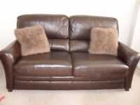 leather 3 seater and two chairs.