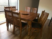 Timber 8 seater dinning table and matching chairs Darling Downs Preview