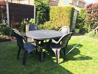 Garden table and four chairs - great condition