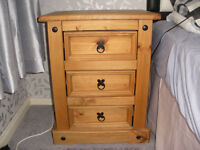 a pair of bed side tables