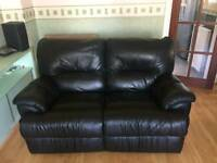 DFS Black leather recliner sofas.