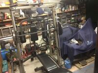 NAUTILUS NT-SM1 PROFESSIONAL SMITH MACHINE WITH HEAVY DUTY BENCH AND OLYMPIC WEIGHTS.