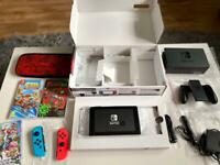 Like new Nintendo switch 32GB 3 games and super mario carry bag.