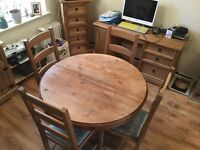 Round pine extending dining table with 4 dining chairs