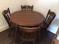 Solid wood round extendable table and 5 chairs for sale - Price Negotiable