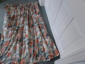 A Pair of Crowson's made to measure lined floral curtains to fit a large bay window.