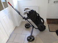 Set of golf clubs with carry bag and pull trolley (used - suitable for a beginner)