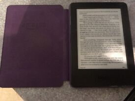 Kindle with cover and clip on light
