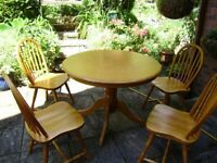 Table and chairs, solid hardwood, very sturdy, can help with delivery