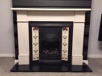 Gas fire, polished granite hearth and lime stone surround