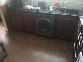 Kitchen units & range oven/hood & integrated fridge/freezer.