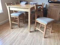 4 wooden chairs with check covers