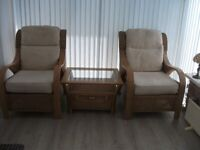 two wicker conservatory chairs and coffee table
